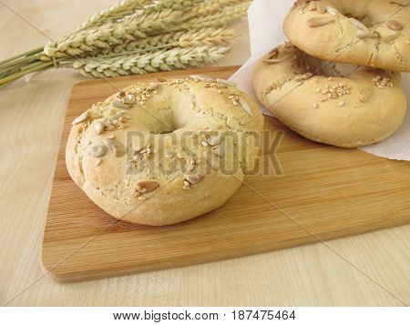 Homemade bagels for breakfast on cutting board