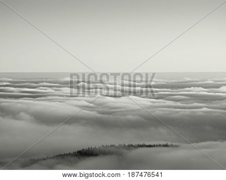 Peaks Of  Mountains Above Creamy Mist.