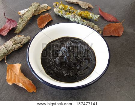 Peat pulp in bowl for bath therapy