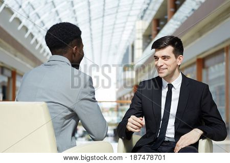 Successful trader negotiating with foreign colleague
