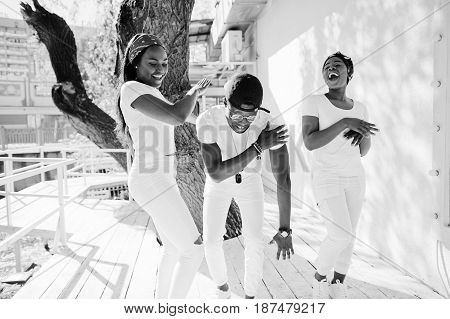 Three Stylish African American Friends, Wear On White Clothes. Street Fashion Of Young Black People.