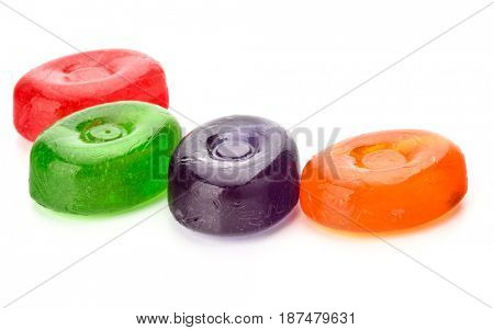 Four colorful fruit hard sugar candies,  boiled sweeties or sugar plums isolated on white background cutout