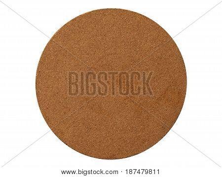 Isolated brown circle coaster corkboard pad closeup