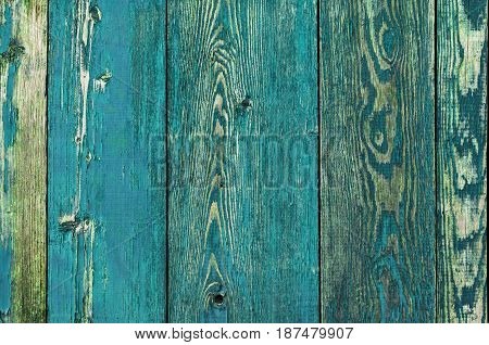 Cracked weathered green and blue painted wooden board texture front view