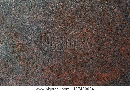 Grungy steel metal wall with heavy corrosion background pattern