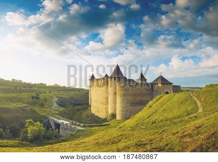 Medieval fortress in a light of sunrise. Khotyn town West Ukraine. The castle is the seventh Wonder of Ukraine.