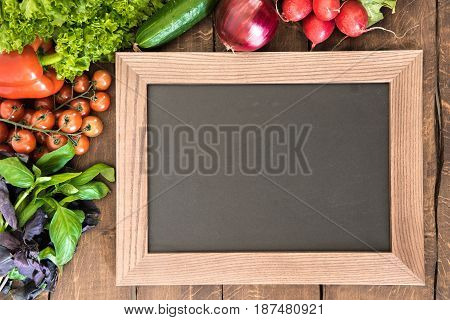 Overhead View Of Blank Chalkboard With Group Of Fresh Vegetables For Cooking Breakfast. Enjoy Your M