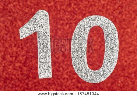 Number ten silver color over a red background. Anniversary. Horizontal