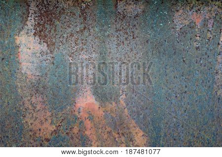 Ferruginous steel metal wall with heavy corrosion background pattern