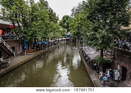 Utrecht Netherlands - August 4 2016: Canal in historic centre of Utrecht. Ancient city centre features many buildings and structures several dating as far back as the High Middle Ages.