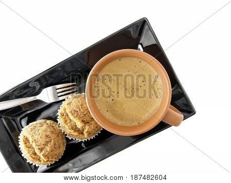 hot coffee with banana cupcakes on black dish, top view and white background, beverage and snack for a coffee break