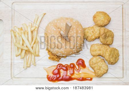Crispy chicken burger with chicken nuggets and french fries