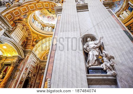 Vatican City - March 25, 2015: Interior of the Saint Peter`s Basilica in the Vatican in Rome, Italy on March 25, 2015. The Saint Peter`s Basilica is an Italian Renaissance church and famous as a place of pilgrimage and for its liturgical functions
