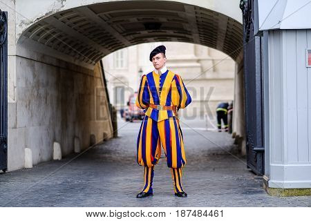 VATICAN CITY - MARCH 25, 2015: A Swiss Soilder on guard at St Peter`s Square in the Vatican, Rome, Italy on March 25, 2015