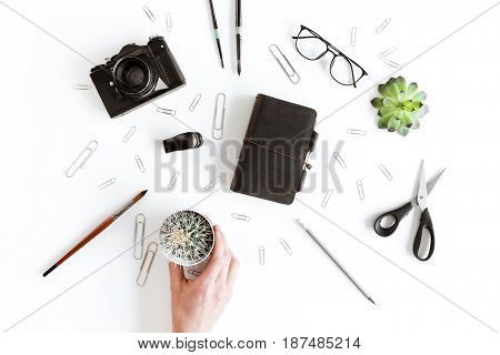 Partial Top View Of Human Hand Holding Cactus And Various Office Supplies And Plant Isolated On Whit