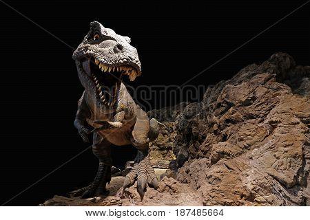 Giant Dinosaur on dry rocky mountain background