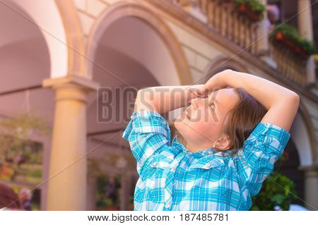 The Girl Raises Her Arms Admiringly And Looks Behind The Head At The Sunlight