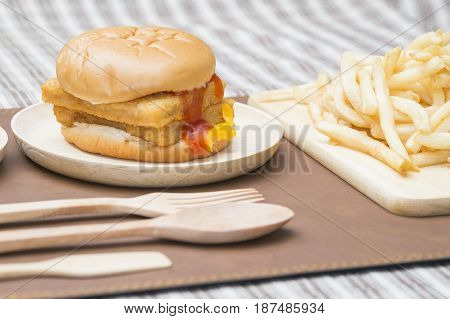 Crispy Fish Burger with chicken nuggets and french fries