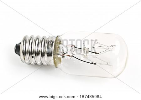 A modern lightbulb beautifully transparent as it's isolated against a white background.