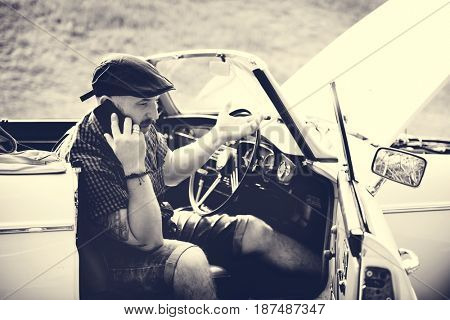Men Calling Mechanic for Broke Down Car on Street Side with Open Hood