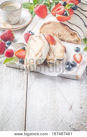 Fresh sweet braided bread in white chocolate with fresh berries