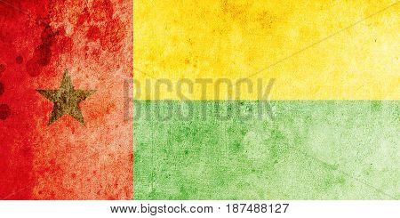 Guinea-Bissau flag grunge background. Background for design in country flag