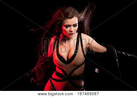 Passionate sensual woman with big breast on black background in studio photo. Sexy and beauty. Fashion and seductive