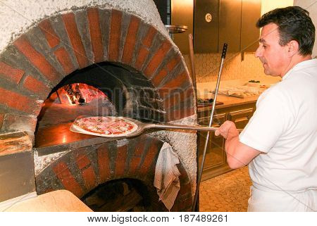 Pizza Maker Bake A Pizza In The Wood Oven