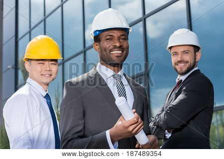 Portrait Of Multiethic Group Of Professional Architects In Hard Hats, Successful Businessmen Concept