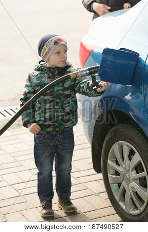 Gomel, Belarus - May 20, 2017: A Child Is Driving A Car At A Gas Station Belarusneft.