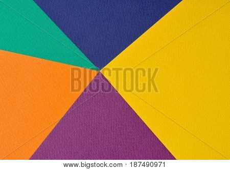 Colorful background - sheets of embossed color paper.