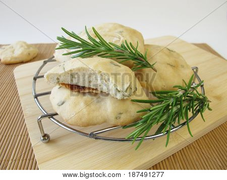 Homemade flat bread pizza cakes with rosemary herbs