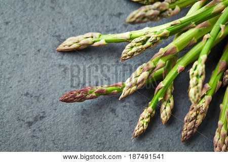 Green Asparagus on stone background