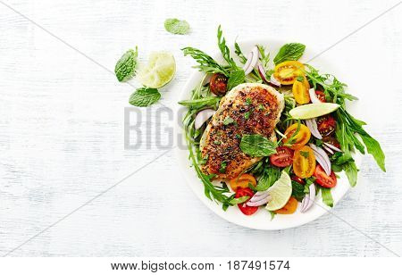 Grilled Chicken Breast on Cherry Tomato and Arugula Salad