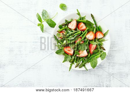 Green Asparagus and Strawberry Salad with Arugula, Mint and Lemon-Honey Dressing