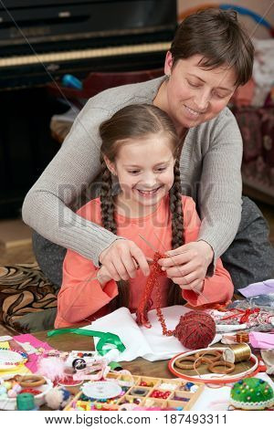 mother and child girl knit, handmade and handicraft concept