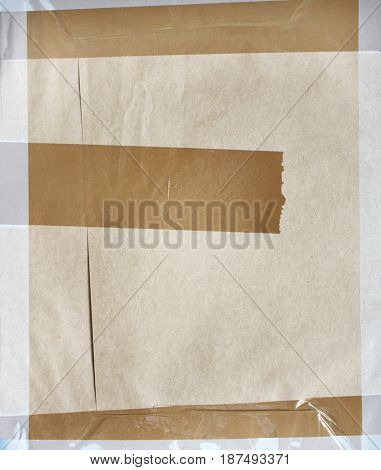 Background with paper texture and stick tape of brown color. Copy space for your text