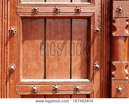 Detail of ancient wooden door with metallic rivets in Taj Mahal mausoleum, India. Copy space for your text