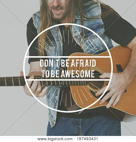 Don't Afraid To Be Awesome Word on Man Playing Guitar Background