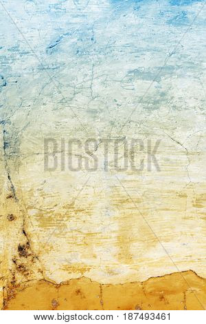 Grunge background with old stucco wall texture of yellow and blue colors