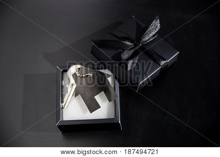 Black gift box with apartment keys - own housing