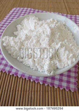 Lactose from milk, milk sugar in bowl