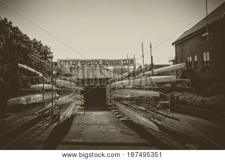A boatshed with canoes all lined up ready to be taken to the water