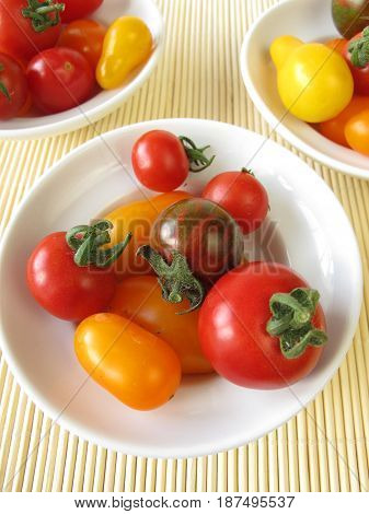 Small tomatoes, cocktail tomatoes, cherry tomatoes in bowls