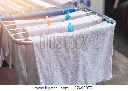 White Towel On Clothesline In Sunny Day