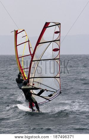 Two windsurfers are catching the wind on Adriatic sea Croatia