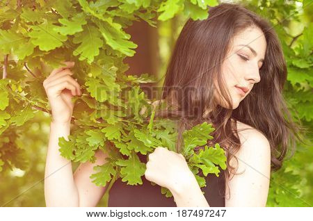 Young And Romantic Female Standing In The Nature