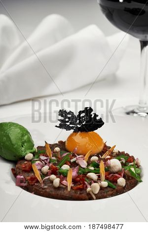 Veal Tartar And Wine In A Restaurant