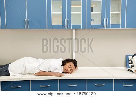 Young Tired Girl Scientist Sleeping On Table In Chemical Laboratory, Chemical Lab