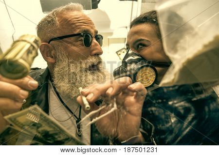 grey hair man with beard taking drugs with woman in personal protective equipment drugs concept